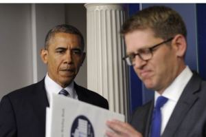 Obama looks upset and Carney looks pissed off!