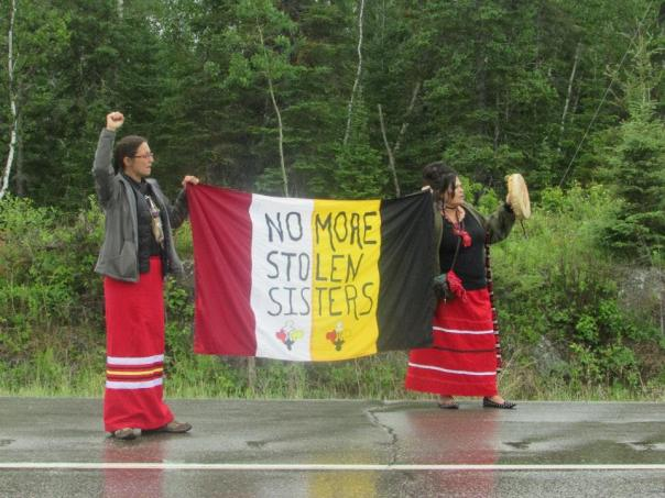 Protesters handed out 1200 informational flyers on missing and murdered Indigenous women and informed the public of the need for a national inquiry. At the Ontario and Manitoba border June 19th 2015. Photo: Red Power Media
