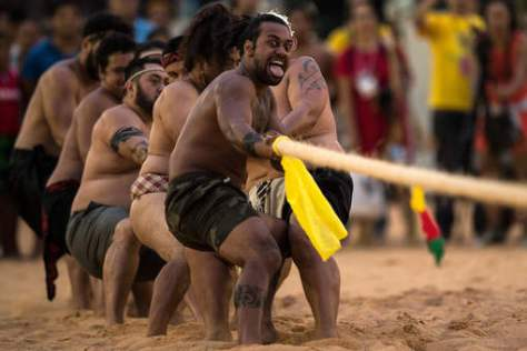 New Zealand Maori in a tug of war competition. (Getty.)
