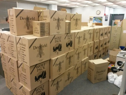 RCMP and Dakota Ojibway Police Service officers seized these boxes of cigarettes, as well as chewing tobacco, firearms and other items, during a raid at a smoke shop at the Dakota Plains First Nation in January 2014. (RCMP)